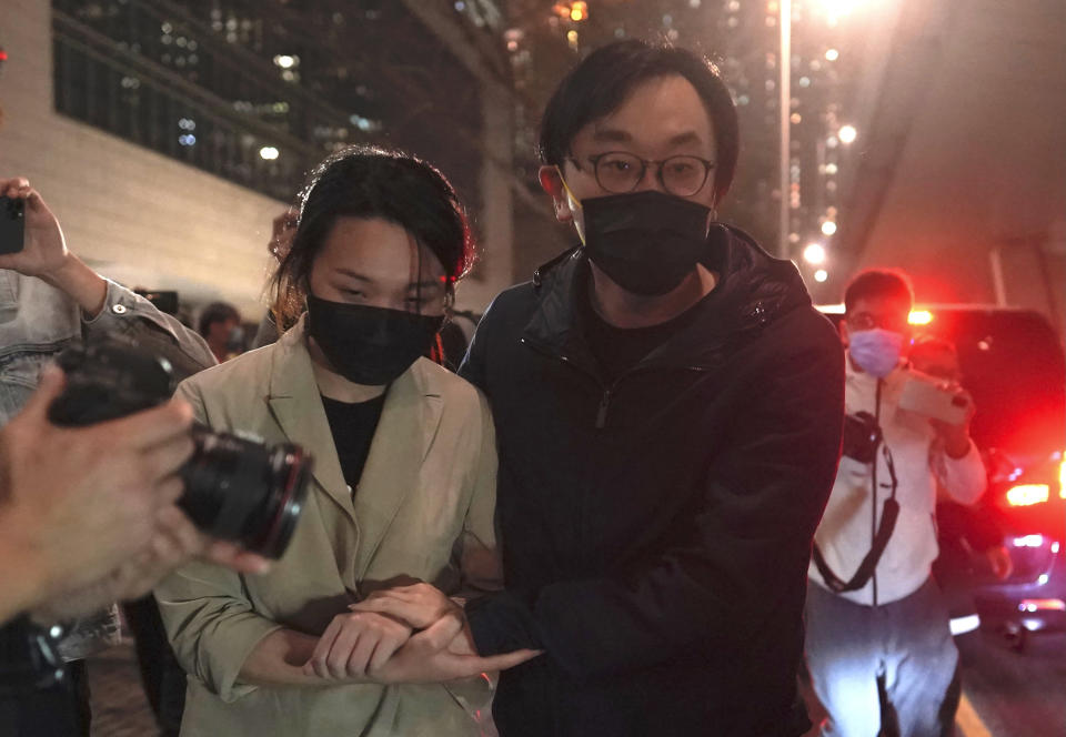 Mike Lam and his wife leave after he was released on bail at a court in Hong Kong, Friday, March 5, 2021. Four of the 47 pro-democracy activists charged with conspiracy to commit subversion, including Lam, were released on bail Friday after prosecutors dropped an appeal against the court's decision to grant them bail. (AP Photo/Kin Cheung)