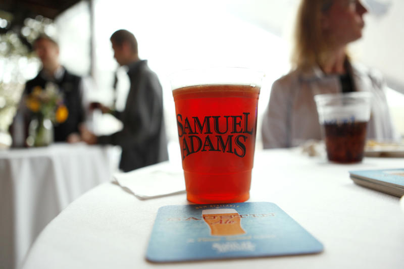 COMMERCIAL IMAGE - In this photograph released by Samuel Adams on Monday, Mar. 12, 2012, Samuel Adams tapped the kegs on its first ever crowd sourced beer, B'Austin Ale, over the weekend at Guy Kawasaki's Girl + Guy Party in Austin, Tex. Facebook fans had the opportunity to weigh in on different attributes of this beer, resulting in a slightly hazy, medium-bodied, amber ale. Samuel Adams will also be releasing the recipe for B'Austin Ale via Facebook so fans can try brewing it at home.  Follow @SamuelAdamsBeer on Twitter for updates. (Erich Schlegel/AP Images for Samuel Adams)