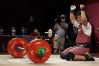 Fares Ibrahim Elbach of Qatar celebrates after winning the gold medal in the men's 81kg weightlifting event, at the 2020 Summer Olympics, Saturday, July 31, 2021, in Tokyo, Japan. (AP Photo/Luca Bruno)