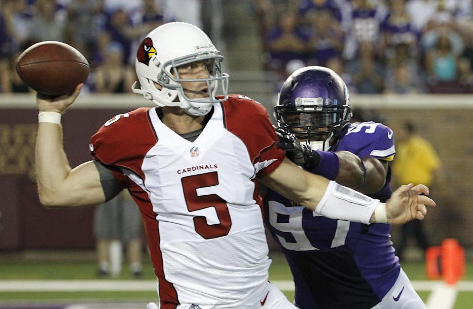 Arizona Cardinals quarterback Drew Stanton (5) is pressured by Minnesota Vikings defensive end Everson Griffen while throwing a pass during the first half of an NFL preseason football game, Saturday, Aug. 16, 2014, in Minneapolis. (AP Photo/Ann Heisenfelt)