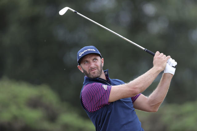 Dustin Johnson plays a shot during a practice round for the The Open Championship golf tournament at Carnoustie Golf Links in Angus, Scotland, Monday July 16, 2018. (Richard Sellers/PA via AP)
