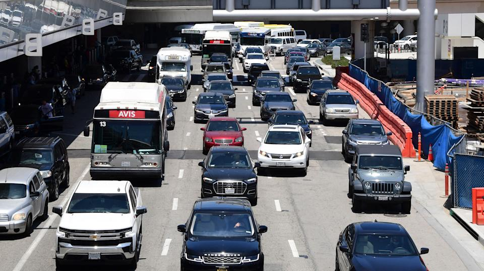 Heavy traffic is seen at Los Angeles International Airport (LAX) on May 27, 2021 in Los Angeles, as people travel for Memorial Day weekend, which marks the unofficial start of the summer travel season. - Global air passenger numbers could rebound from the coronavirus pandemic to top 2019 levels by 2023, the International Air Transport Association predicted on May 26. (Photo by Frederic J. BROWN / AFP) (Photo by FREDERIC J. BROWN/AFP via Getty Images)