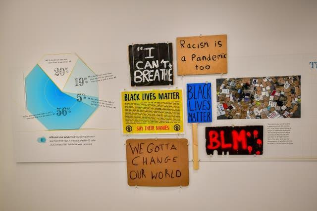 Placards from the protest are on display (Ben Birchall/PA)