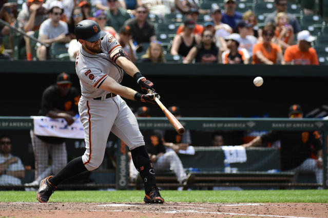 San Francisco Giants' Evan Longoria hits a ground rule double scoring Stephen Vogt and Steven Duggar in the fifth inning of an interleague baseball game against the Baltimore Orioles, Sunday, June 2, 2019, in Baltimore. (AP Photo/Tommy Gilligan)