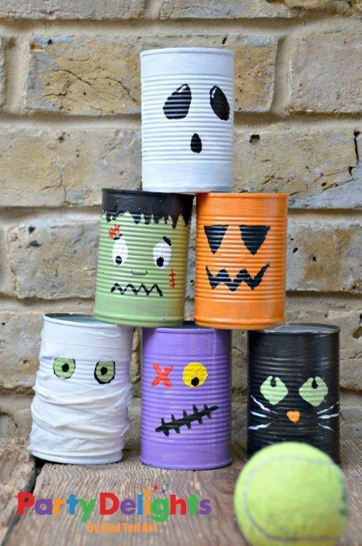 """<p>Here's another festive twist on bowling: Paint faces on cans, and then stack the scary (okay, more like cute) dudes to see how many you knock down in one shot. </p><p><em><a href=""""http://blog.partydelights.co.uk/halloween-party-activity-tin-can-bowling/"""" rel=""""nofollow noopener"""" target=""""_blank"""" data-ylk=""""slk:Get the tutorial at Party Delights »"""" class=""""link rapid-noclick-resp"""">Get the tutorial at Party Delights »</a></em> </p>"""