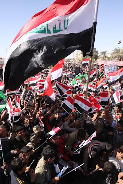 People chant anti-Iraqi Government slogans and wave Iraqi flags during a protest in Basra, Iraq's second-largest city, 550 kilometers (340 miles) southeast of Baghdad, Iraq, Monday, March 19, 2012. Followers of the anti-American Shiite cleric Muqtada al-Sadr are demanding better living conditions in Iraq on the ninth anniversary of the U.S.-led invasion of their country . (AP Photo/Nabil al-Jurani)