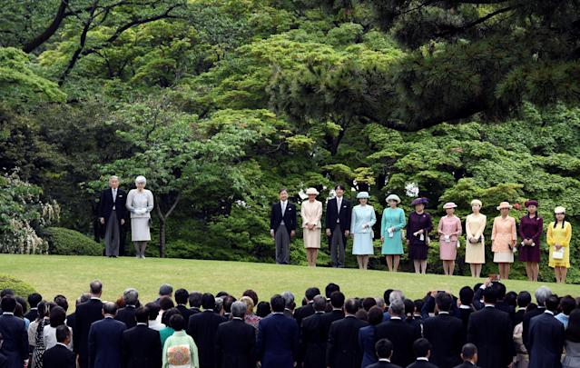 Japanese Emperor Akihito (L) and Empress Michiko (2nd L) stand on a along with, (L-R) Crown Prince Naruhito, Crown Princess Masako, Prince Akishino, Princess Kiko, Princess Mako, Princess Nobuko, Princess Akiko, Princess Yoko, Princess Hisako, Princess Tsuguko and Princess Ayako, during the spring garden party hosted by the Emperor in Tokyo, Japan April 25, 2018. Toshifumi Kitamura/Pool via Reuters TPX IMAGES OF THE DAY