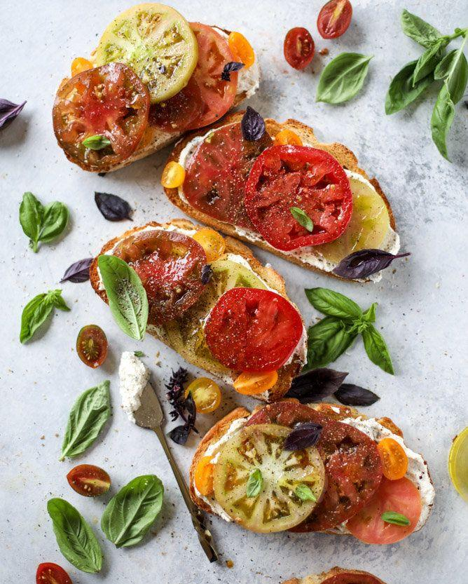"""<strong>Get the <a href=""""http://www.howsweeteats.com/2017/07/heirloom-tomato-toast-basil-whipped-feta/"""" rel=""""nofollow noopener"""" target=""""_blank"""" data-ylk=""""slk:Heirloom Tomato Garlic Toast with Basil Whipped Feta recipe"""" class=""""link rapid-noclick-resp"""">Heirloom Tomato Garlic Toast with Basil Whipped Feta recipe</a>&nbsp;from How Sweet It Is</strong>"""