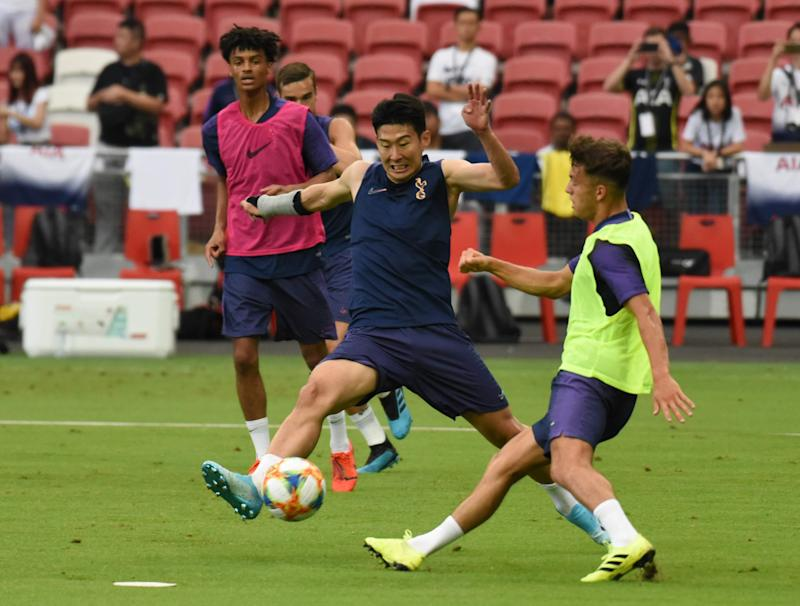 Tottenham Hotspur's South Korea forward Son Heung-min tussles for the ball during training at National Stadium for the International Champions Cup. (PHOTO: Zainal Yahya/Yahoo News Singapore)