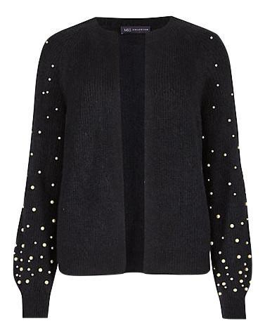 """<p>Looking for a cardie which will carry you from work to drinks in one fashionable move? Look no further than this pearl-embroidered knit. <em><a rel=""""nofollow noopener"""" href=""""http://www.marksandspencer.com/pearl-sleeve-open-front-cardigan/p/p60139040?image=SD_01_T38_4502_F0_X_EC_90&color=NAVY&prevPage=plp"""" target=""""_blank"""" data-ylk=""""slk:Marks and Spencer"""" class=""""link rapid-noclick-resp"""">Marks and Spencer</a>, £35</em> </p>"""