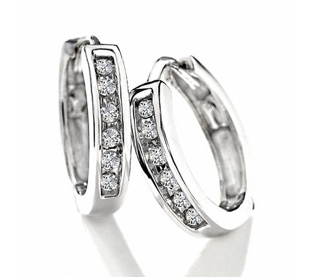 Diamond Huggie Hoop Earrings in 10K White Gold. Image via Peoples.