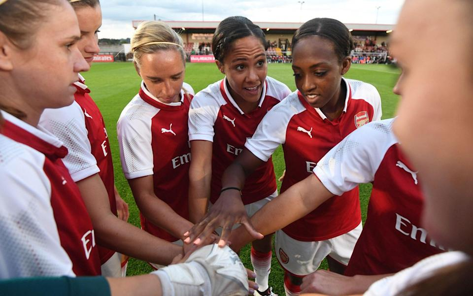 Alex Scott, flanked by Jordan Nobbs and Danielle Carter, with Arsenal in 2017 - GETTY IMAGES