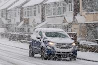 Cars make their way through heavy snow in Dunstable, Bedfordshire. Picture date: Sunday January 24, 2021. (Photo by Joe Giddens/PA Images via Getty Images)
