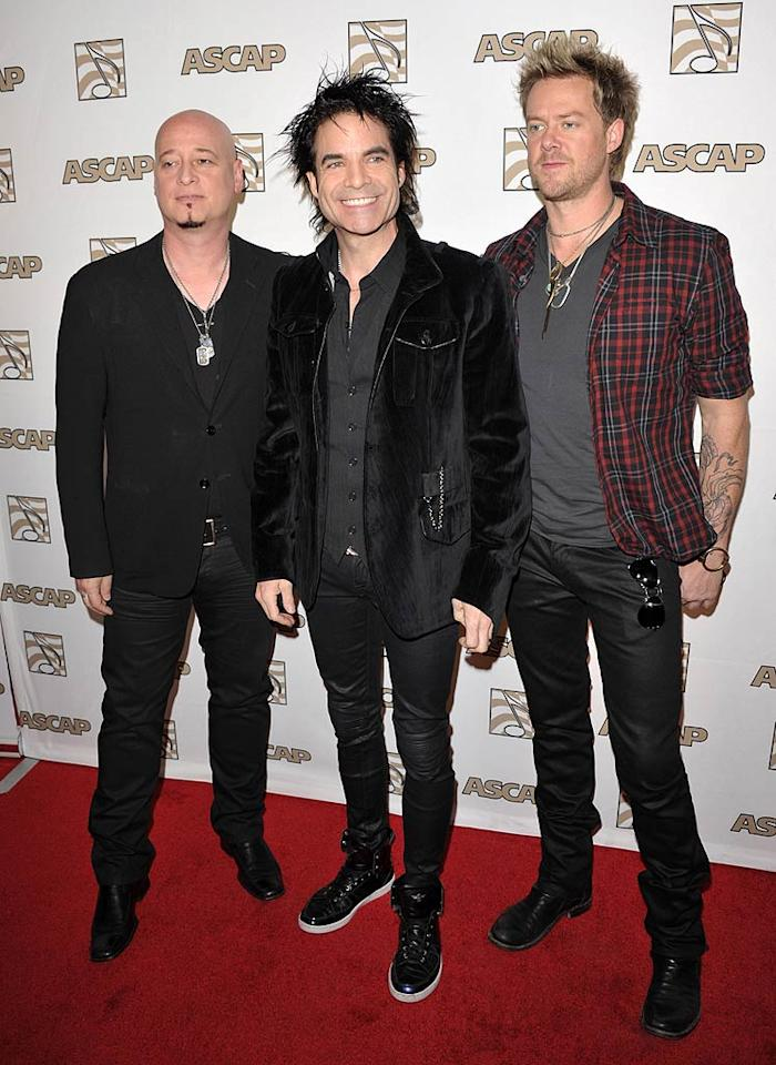 "Scott Underwood, Patrick Monahan, and Jimmy Stafford -- better known as the band Train -- also attended the awards show where lead singer Monahan took home the song of the year award for writing the band's hit, ""Hey, Soul Sister."" John Shearer/<a href=""http://www.wireimage.com"" target=""new"">WireImage.com</a> - April 27, 2011"