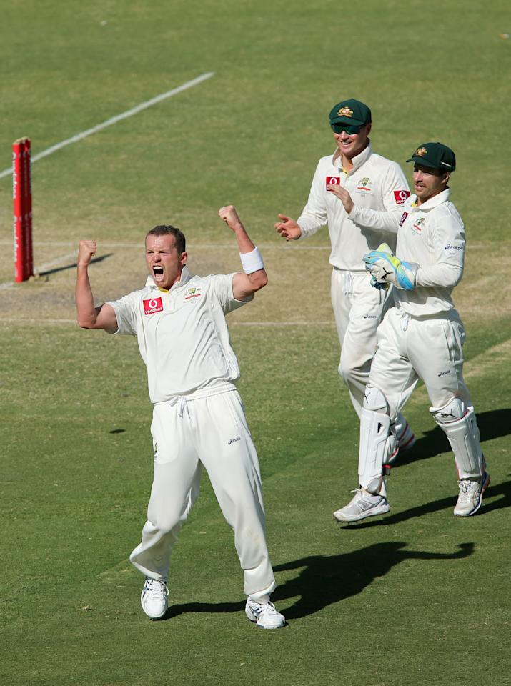 ADELAIDE, AUSTRALIA - NOVEMBER 26: Peter Siddle of Australia celebrates after getting the wicket of Dale Steyn of South Africa during day five of the Second Test Match between Australia and South Africa at Adelaide Oval on November 26, 2012 in Adelaide, Australia.  (Photo by Morne de Klerk/Getty Images)