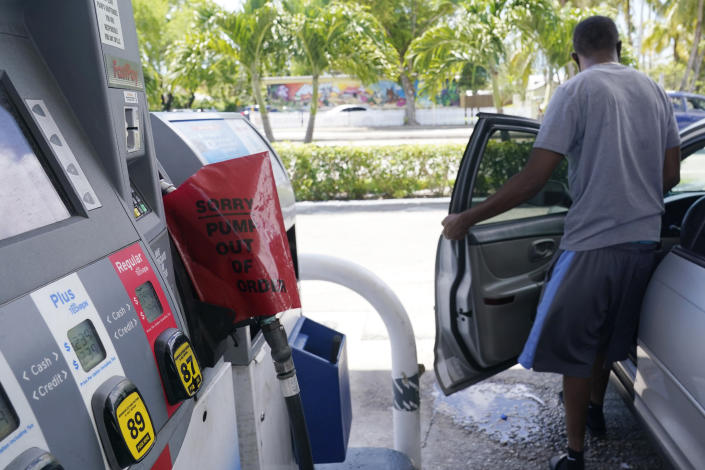 A customer leaves a Chevron station after it ran out of gasoline, Wednesday, May 12, 2021, in Miami. State and federal officials are scrambling to find alternate routes to deliver gasoline in the Southeast U.S. after a hack of the nation's largest fuel pipeline led to panic-buying that contributed to more than 1,000 gas stations running out of fuel. The pipeline runs from the Gulf Coast to the New York metropolitan region, but states in the Southeast are more reliant on the pipeline for fuel. Other parts of the country have more sources to tap. (AP Photo/Marta Lavandier)