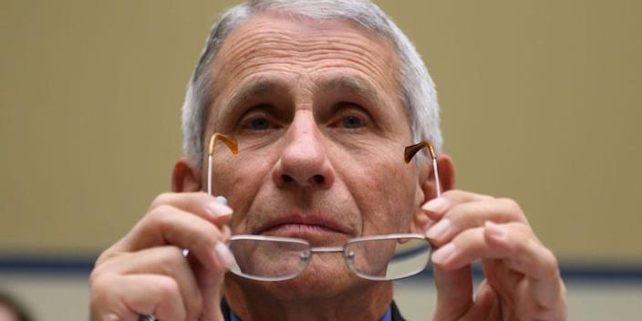"""Dr. Anthony Fauci, Director, National Institute of Allergy and Infectious Diseases at National Institutes of Health, looks on before the start of a House Oversight And Reform Committee hearing concerning government preparedness and response to the COVID-19, coronavirus outbreak, in the Rayburn House Office Building on Capitol Hill March 11, 2020 in Washington, DC. <p class=""""copyright"""">ANDREW CABALLERO-REYNOLDS/AFP via Getty Images</p>"""