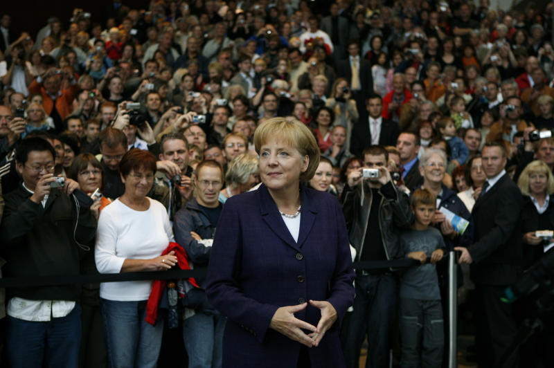 """FILE - In this Sunday, Aug. 24, 2008 file photo German Chancellor Angela Merkel, center, welcomes visitors at the """"Day of the open door"""" during her first term at the Chancellery in Berlin, Germany. Merkel runs for a third term in Germany's general election on Sunday, Sept. 22, 2013. (AP Photo/Markus Schreiber, File)"""