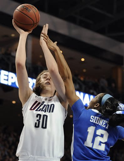 Connecticut's Breanna Stewart (30) is fouled as she makes a basket by Kentucky's Jelleah Sidney (12) during the second half of a regional final game in the NCAA college basketball tournament in Bridgeport, Conn., Monday, April 1, 2013. (AP Photo/Jessica Hill)