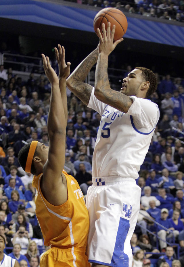 Kentucky's Willie Cauley-Stein (15) shoots over Tennessee's Jarnell Stokes (5) during the first half of an NCAA college basketball game, Saturday, Jan. 18, 2014, in Lexington, Ky. (AP Photo/James Crisp)