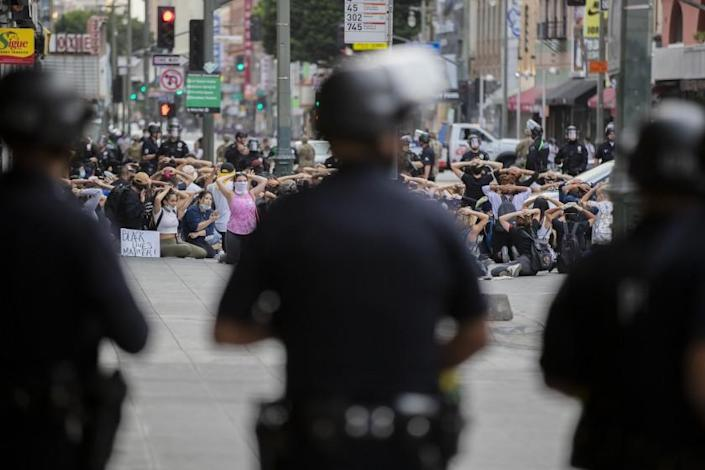 "Dozens of protesters are arrested for curfew violations in downtown Los Angeles on June 2. <span class=""copyright"">(Los Angeles Times)</span>"