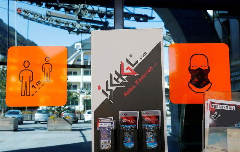 FILE PHOTO: Signs are seen at the entrance of a lift station in the Tyrolean ski resort of Ischgl