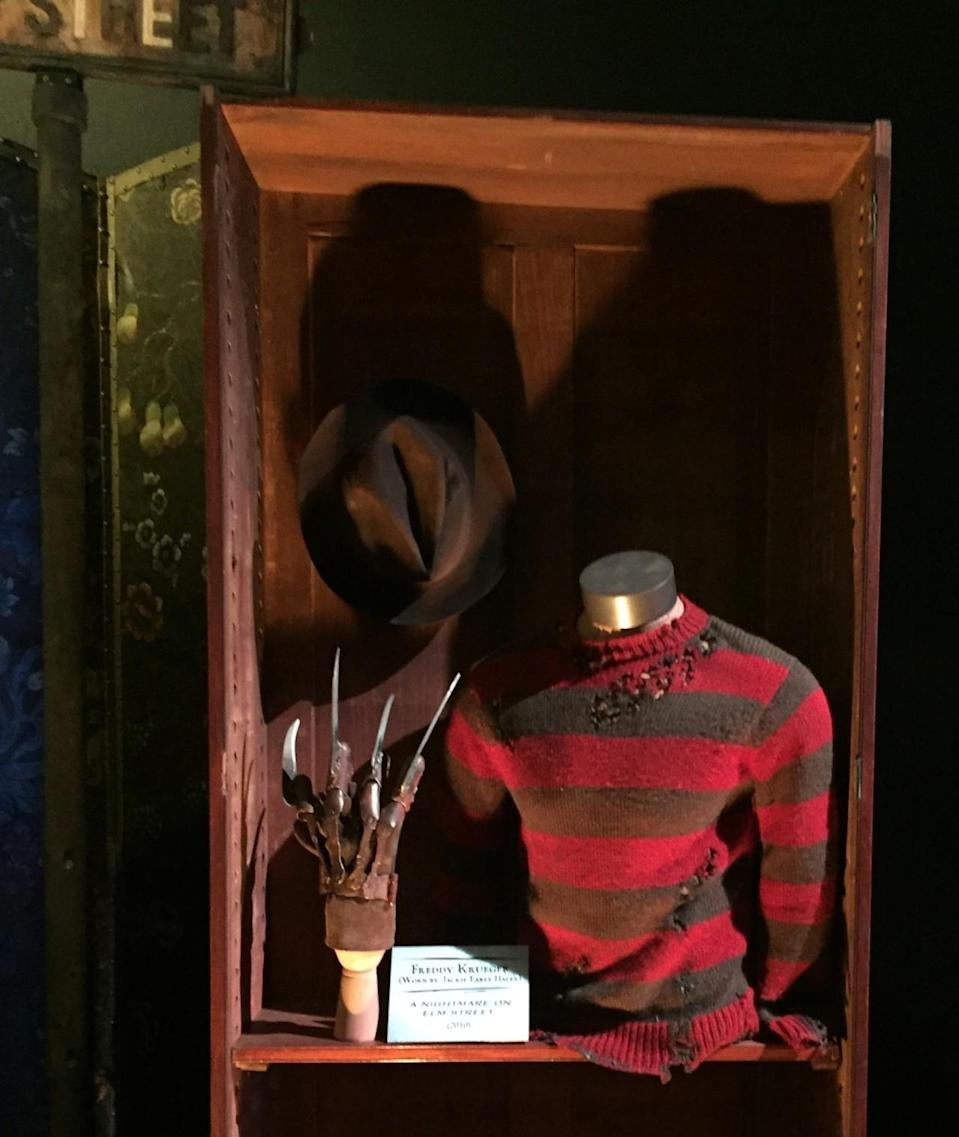 """<p>Jackie Earle Haley wore the infamous striped sweater and razor gloves (modeled after <a rel=""""nofollow"""" href=""""https://www.yahoo.com/movies/role-recall-robert-englund-on-making-nightmares-101449769362.html"""" data-ylk=""""slk:Robert Englund's original Freddy Krueger get-up;outcm:mb_qualified_link;_E:mb_qualified_link;ct:story;"""" class=""""link rapid-noclick-resp yahoo-link"""">Robert Englund's original Freddy Krueger get-up</a>) in the 2010 reboot of the horror classic. A portion of the Elm Street sign can be seen in the upper left corner. (Photo: Marcus Errico/Yahoo) </p>"""