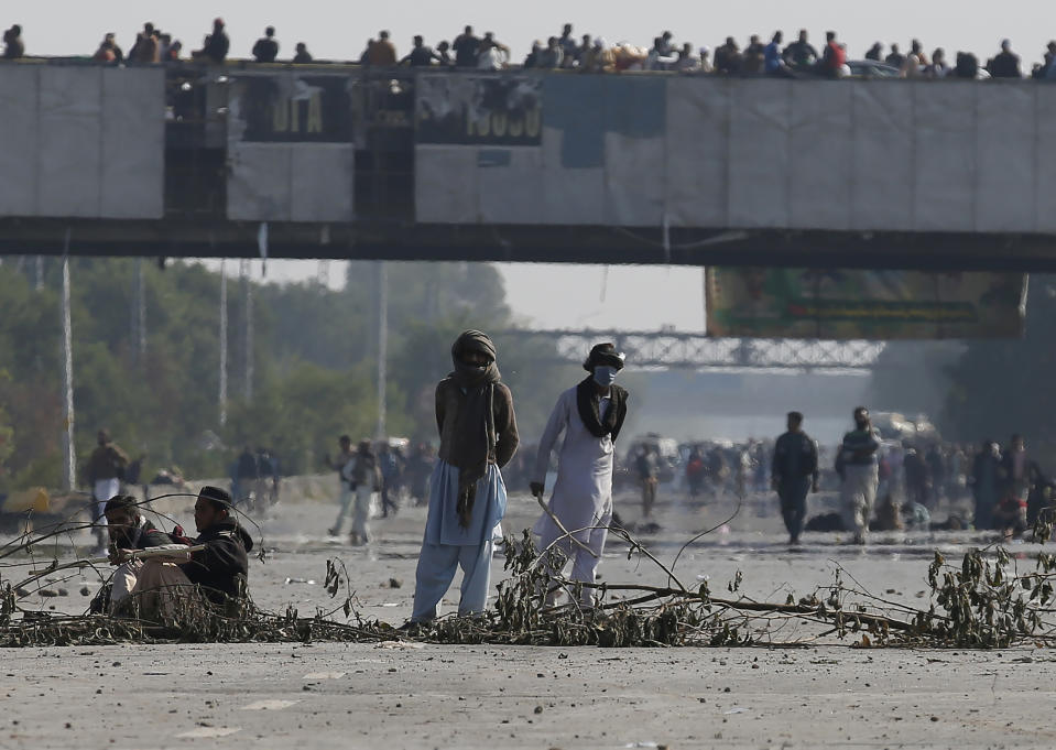 Supporters of 'Tehreek-e-Labaik Pakistan, a religious political party, block a main road during an anti-France rally in Islamabad, Pakistan, Monday, Nov. 16, 2020. The supporters are protesting the French President Emmanuel Macron over his recent statements and the republishing in France of caricatures of the Muslim Prophet Muhammad they deem blasphemous. (AP Photo/Anjum Naveed)