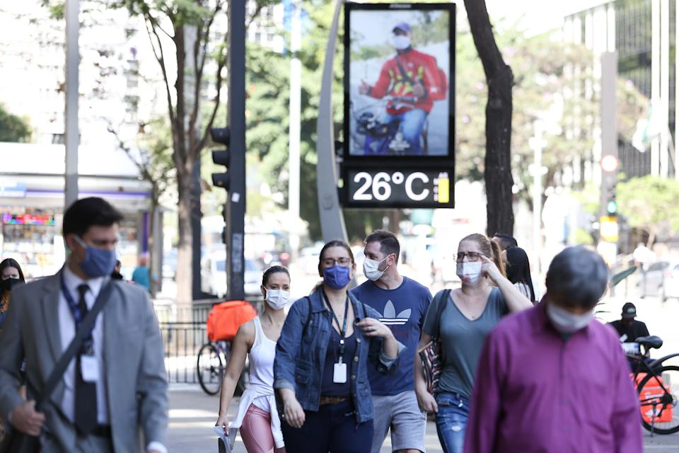 SAO PAULO, Aug. 12, 2020 -- Pedestrians wearing face masks walk on the street in Sao Paulo, Brazil, Aug. 12, 2020.   Brazil on Wednesday said it registered 1,175 deaths from the novel coronavirus COVID-19 in the previous 24 hours, raising the death toll to 104,201.    According to the Brazilian Ministry of Health's daily pandemic report, tests detected 55,155 new cases of infection in the same 24-hour period, taking the total caseload to 3,164,785.    A total of 2,309,477 patients have recovered. (Photo by Xinhua/Xinhua via Getty) (Xinhua/ via Getty Images)