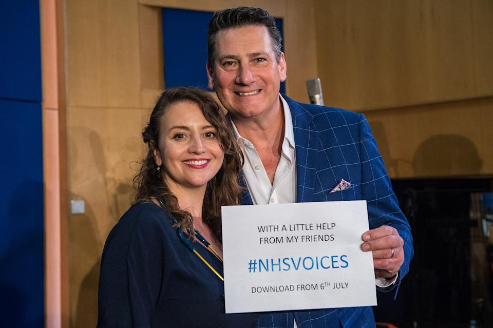 LONDON, ENGLAND - JUNE 14: Dr. Katie Rogerson, choir leader and Tony Hadley during the recordings of NHS Voices charity single 'With A Little Help Of My Friends' at Abbey Road Studios, June 14, 2018 in London, England. (Photo by Brian Rasic/WireImage)
