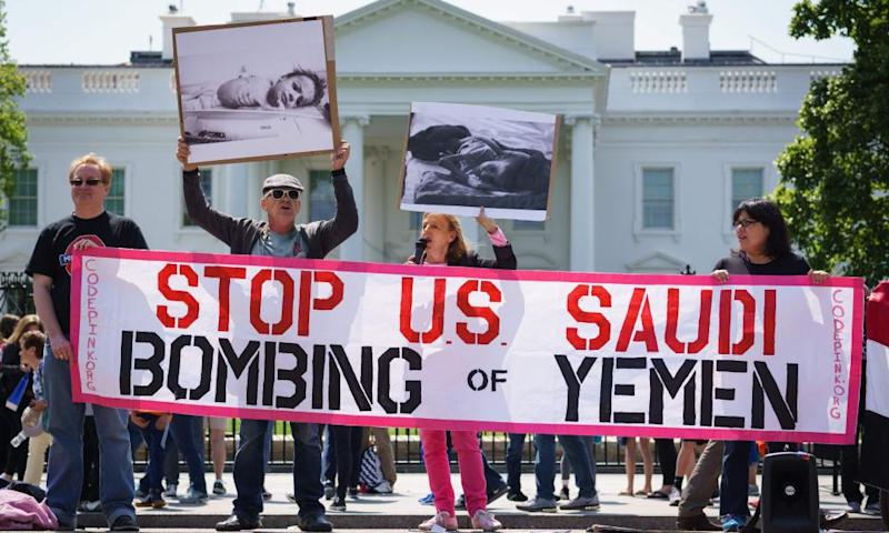 Activists take part in a rally in front of the White House to protest against Saudi Arabia's actions in Yemen.