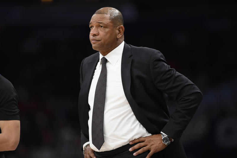 Los Angeles Clippers head coach Doc Rivers stands on the court during the first half of an NBA basketball game against the Washington Wizards, Sunday, Dec. 8, 2019, in Washington. (AP Photo/Nick Wass)