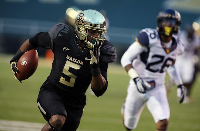 Baylor wide receiver Antwan Goodley (5) scores against West Virginia cornerback Travis Bell (26), right, during the first half of an NCAA college football game on Saturday, Oct. 5, 2013, in Waco, Texas. (AP Photo/Rod Aydelotte)
