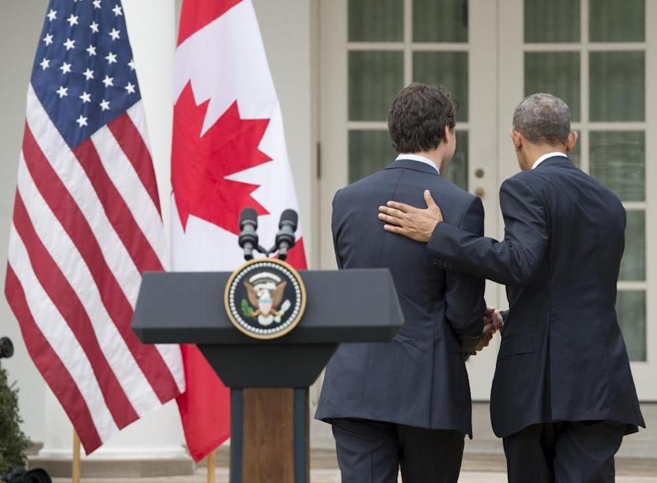US President Barack Obama and Canadian Prime Minister Justin Trudeau leave following a joint press conference in the Rose Garden of the White House on March 10, 2016 (AFP Photo/Saul Loeb)