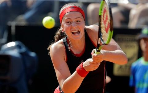 Jelena Ostapenko shapes to strike a backhand  - Credit: AP
