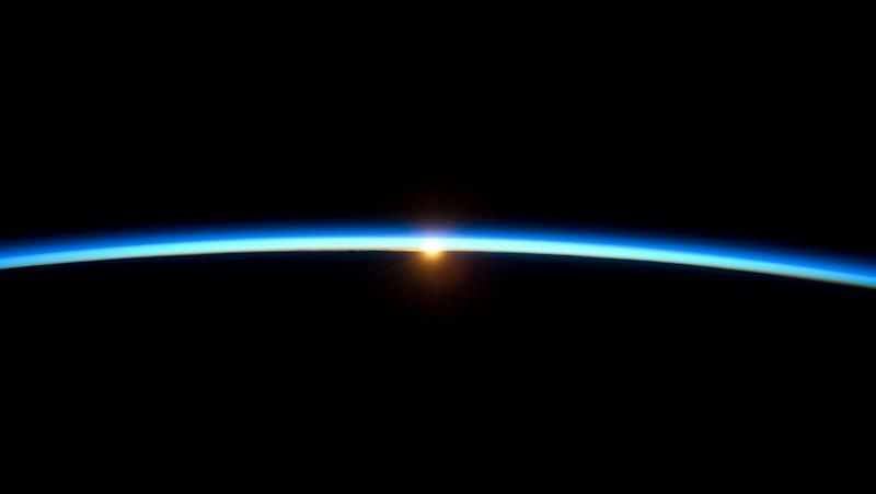 The thin line of Earth's atmosphere and the setting sun are featured in this image photographed by a crew member on the International Space Station while space shuttle Atlantis (STS-129) remains docked with the station. 11/23/09
