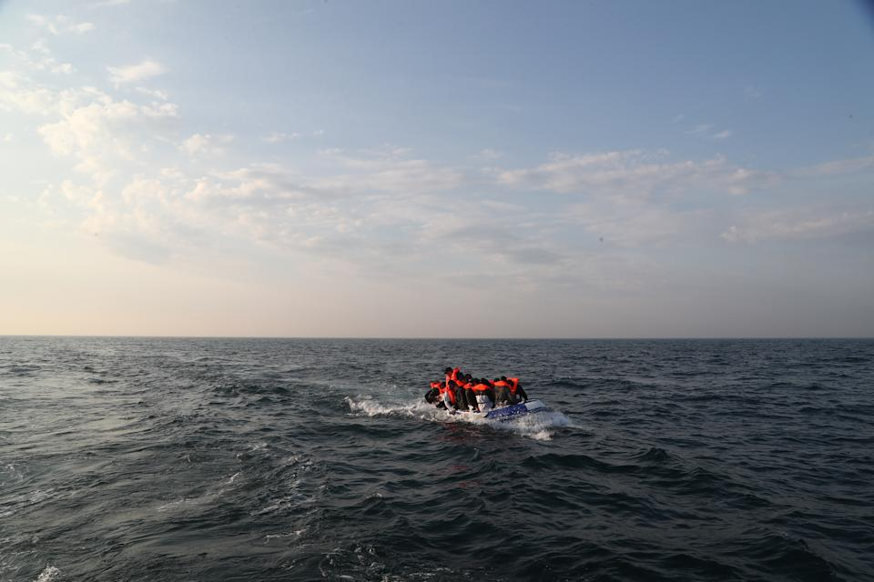 A group of people thought to be migrants crossing The Channel in a small boat headed in the direction of Dover, Kent. (Photo by Gareth Fuller/PA Images via Getty Images)