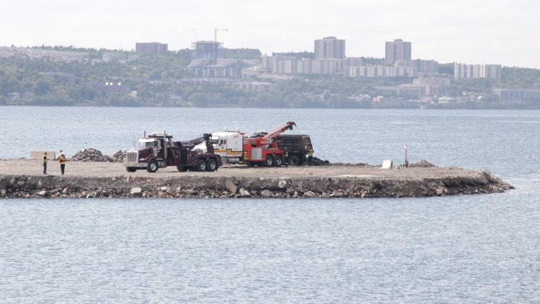 Dump truck pulled from water near site of workplace fatality