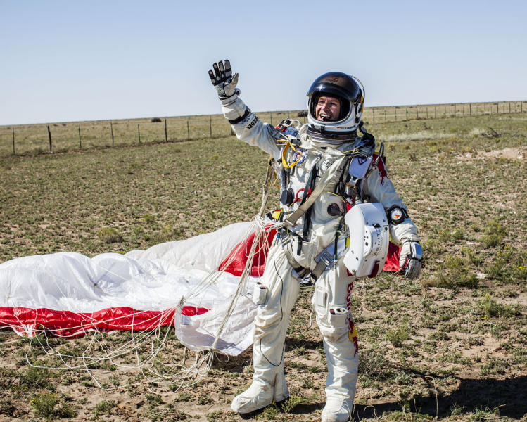 FILE - In this Sunday, Oct. 14, 2012 photo provided by Red Bull Stratos, Pilot Felix Baumgartner of Austria celebrates after successfully completing the final manned flight for Red Bull Stratos in Roswell, N.M. Baumgartner's death-defying jump from a balloon 24 miles above Earth yielded important information about the punishing effects of extreme speed and altitude on the human body - insights that could inform the development of improved spacesuits, new training procedures and emergency medical treatment. (AP Photo/Red Bull Stratos, Balazs Gardi)