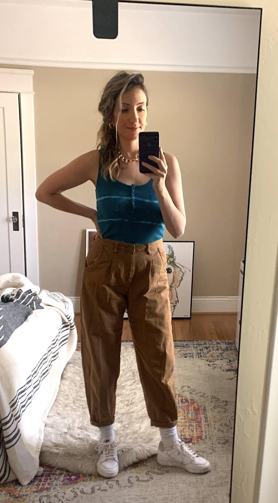 """<p><strong>The item:</strong> <span>Old Navy Fitted Rib-Knit Henley Tank</span> (Sold Out) </p><p><strong>What our editor said</strong>: """"When it arrived I immediately tried it on with my favorite mom jeans, and the fit was perfect. The tank is soft and flattering without being too tight - some ribbed tanks can feel too restricting, as though I'm wearing a sports bra.I loved that there is just enough stretch in the fabric (it's made of five percent spandex)."""" - RB</p> <p>If you want to read more, here is the <a href=""""http://www.popsugar.com/fashion/best-tie-dye-tank-top-at-old-navy-47588994"""" class=""""link rapid-noclick-resp"""" rel=""""nofollow noopener"""" target=""""_blank"""" data-ylk=""""slk:complete review."""">complete review.</a></p>"""