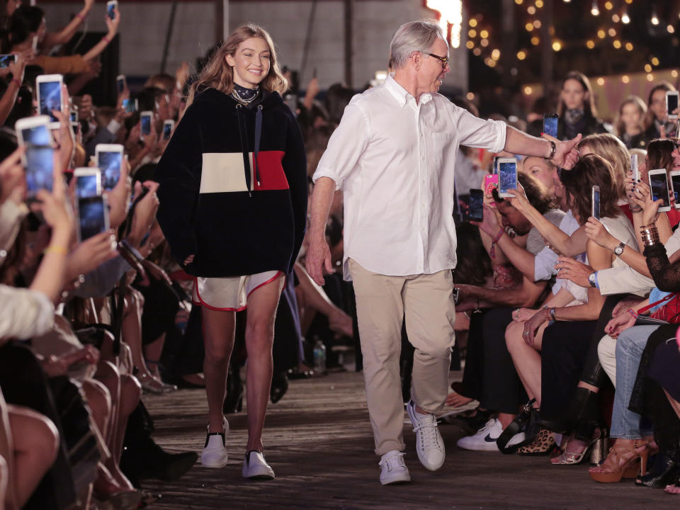 <p>September 2016 saw TommyPier open to the public. Set on New York's Pier 16, the two-day extravaganza was the first joint collection between Tommy Hilfiger and Gigi Hadid. <br><em>[Photo: Getty]</em> </p>