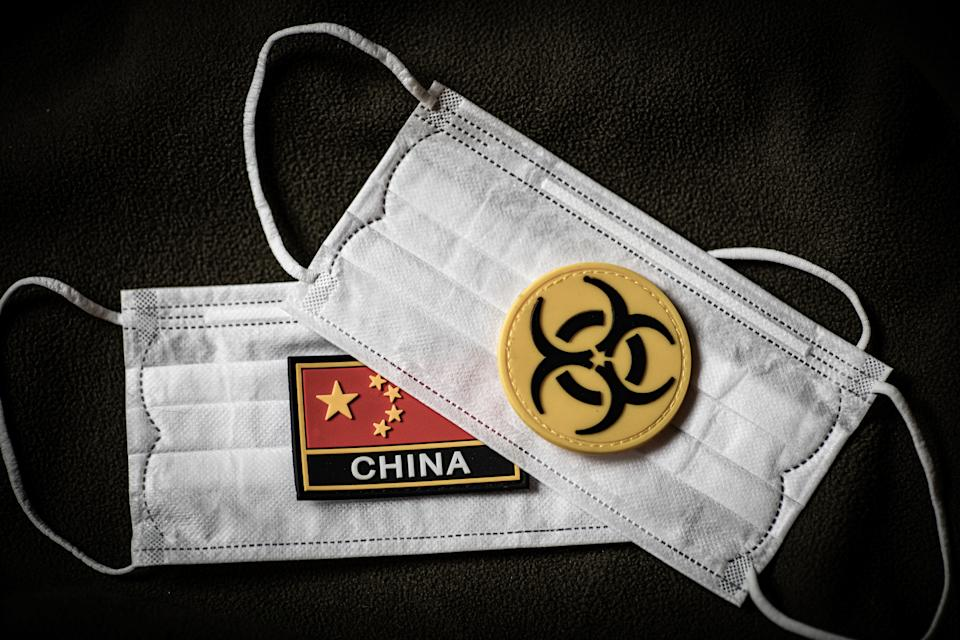 Close up of surgical masks with China and biohazard logos.
