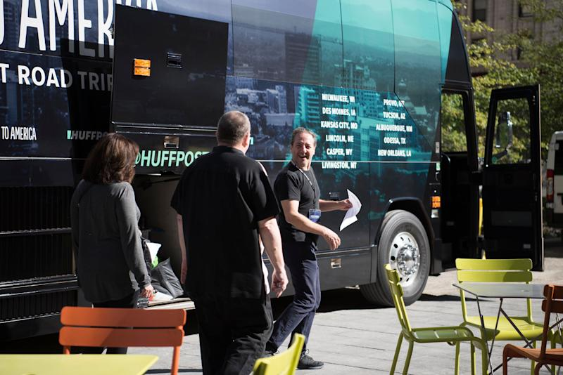 Jo Confino leads prospective interviewees to the bus.