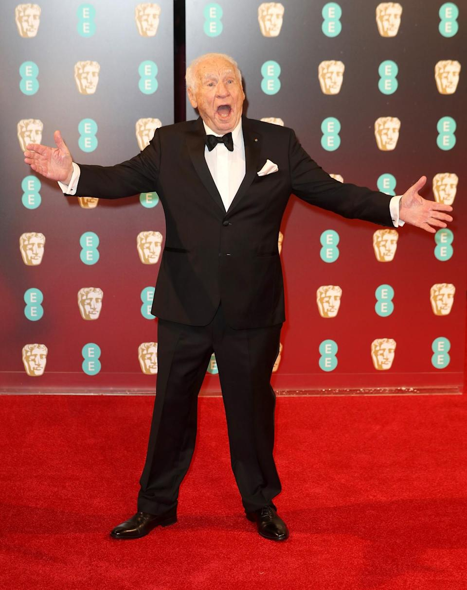 <p>The funny guy chose a traditional black tux. <i>[Photo: Getty]</i> </p>