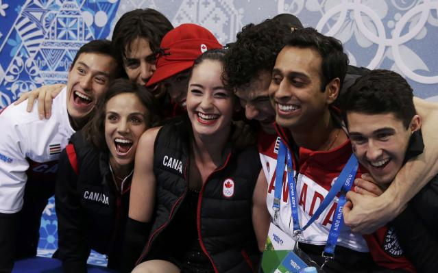 """Kaetlyn Osmond of Canada reacts with teammates and Patrick Chan (L) in the """"kiss and cry"""" area during the Team Ladies Short Program at the Sochi 2014 Winter Olympics, February 8, 2014. REUTERS/Darron Cummings/Pool (RUSSIA - Tags: SPORT FIGURE SKATING SPORT OLYMPICS)"""