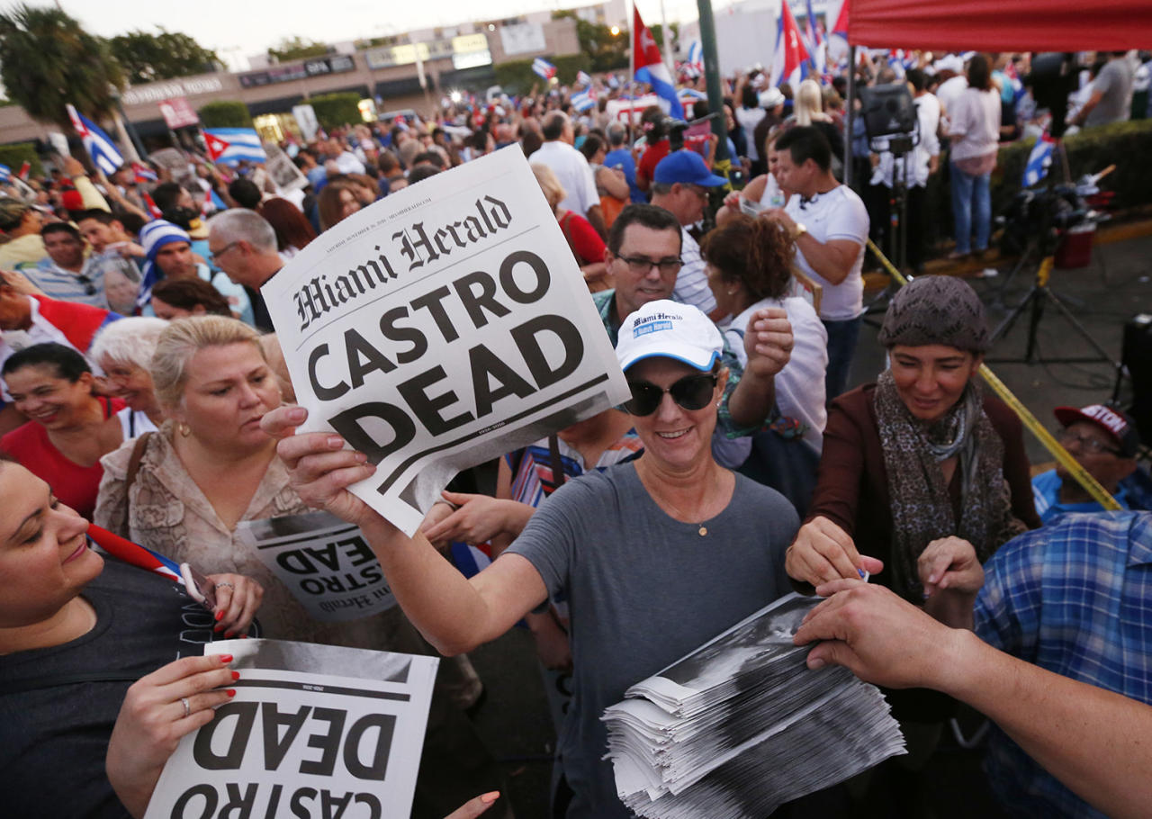 """<p>Alexandra Villoch, president and publisher of the Miami Herald Media Company, hands out a special edition of the Miami Herald with the headline """"Castro Dead,"""" in front of the Versailles Restaurant in the Little Havana neighborhood of Miami as members of the Cuban community react to the death of Fidel Castro, Saturday, Nov. 26, 2016. (AP Photo/Wilfredo Lee) </p>"""