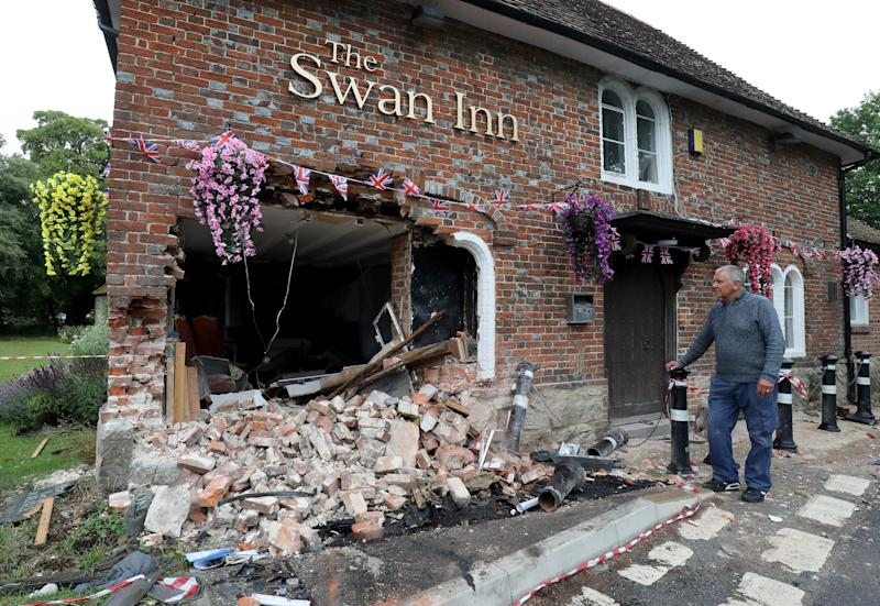 Ray Perkins, Landlord of The Swan Inn in Ashford, Kent, looks at the damage to his pub after a car crashed into the pub during the early hours of this morning wrecking their plans for reopening as coronavirus lockdown restrictions are eased across England.