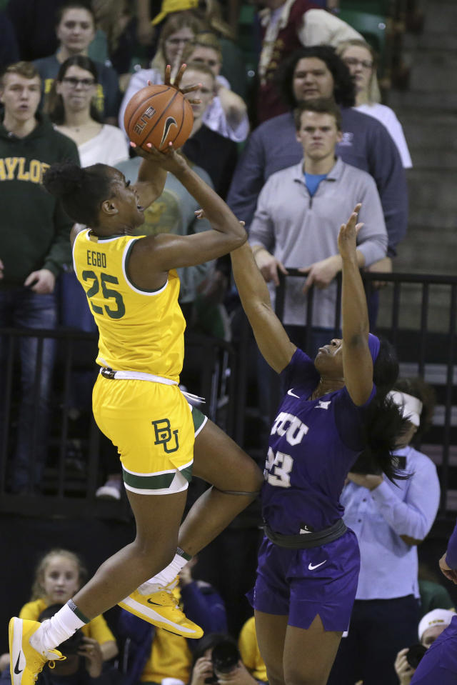 Baylor center Queen Egbo (25) scores over TCU forward Michelle Berry (23) in the first half of an NCAA college basketball game, Wednesday, Feb. 12, 2020, in Waco, Texas. (AP Photo/Jerry Larson)