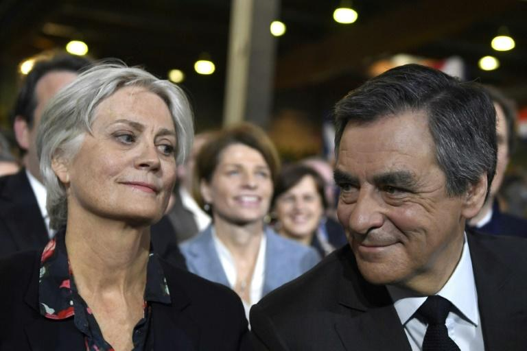 French right-wing candidate for the upcoming presidential election Francois Fillon (R) flanked by his wife Penelope (L), looks on during a campaign rally in Paris in January 2017