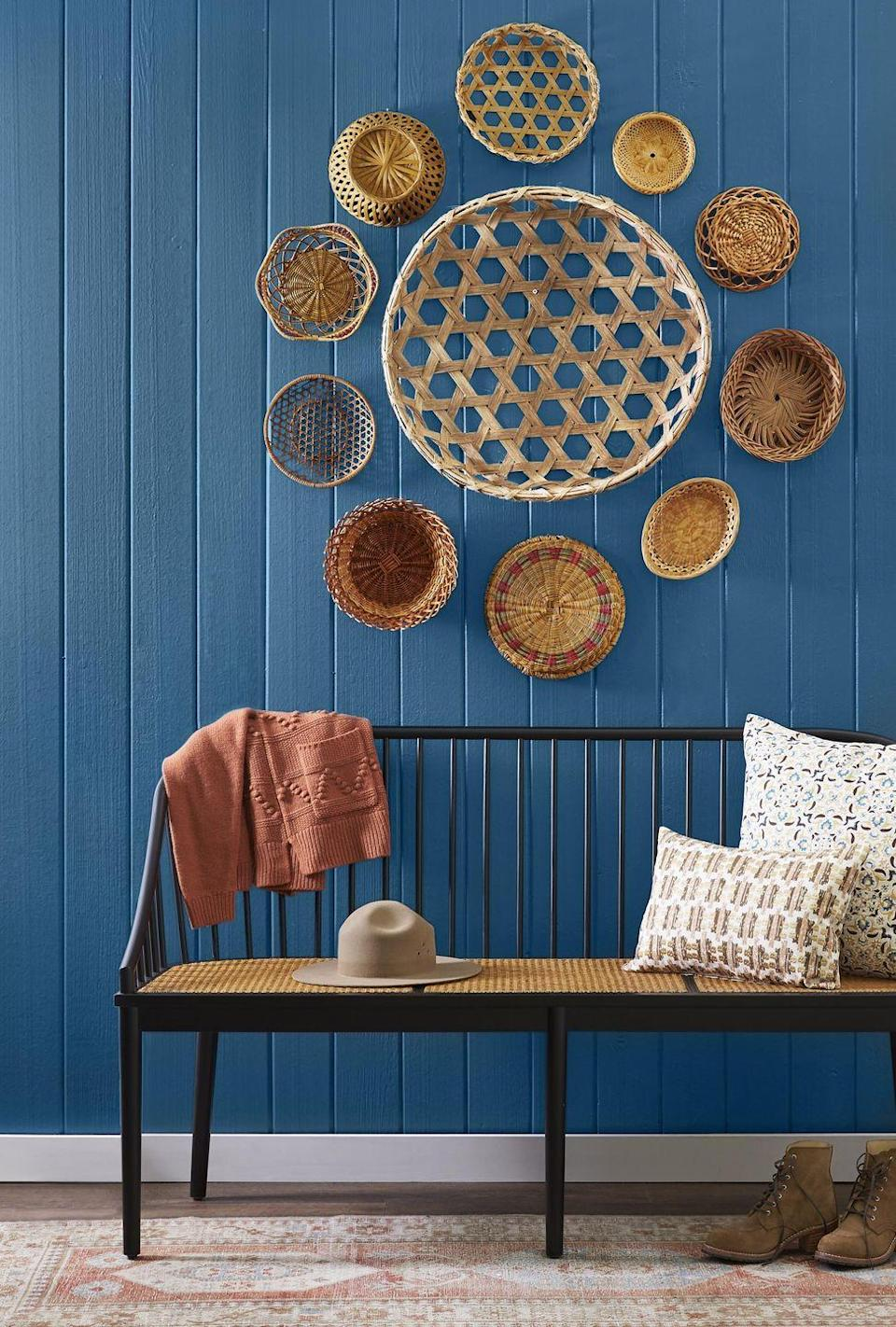 <p>An array of baskets in different sizes, shapes, and colors is all it takes to transform a ho-hum wall into the rooms focal point. <strong><br></strong></p><p><strong>To make: </strong>Using nails, hang a larger basket in the middle, then surround with smaller baskets in a circular or starburst pattern.<br></p>